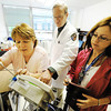 Globe/T. Rob Brown Medical team, from left, Julie Gregory, L.P.N., Dr. Thomas Davis and Kathy Alexander, R.N., prepare a blood pressure and vital signs monitor at the Gene Taylor Satellite Outpatient Clinic of the Department of Veterans Affairs in Mount Vernon Wednesday morning, June 27, 2012.