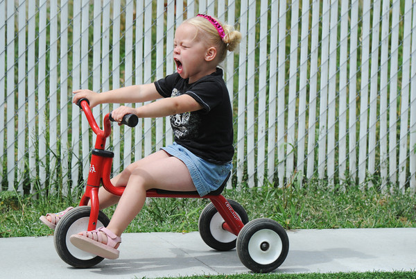 Globe/T. Rob Brown Brianna Morris, 2, yells with excitement as she races around a paved track on a three-wheeler Tuesday afternoon, June 19, 2012, at the Learning Junction Educational Center in Joplin.