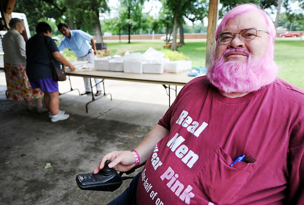"""Globe/T. Rob Brown<br /> Cancer survivor Chet Sweet, of Girard, Kan., sports pink-dyed hair and beard while wearing a """"Real Men Wear Pink"""" T-shirt for the National Cancer Survivors Day event at Lincoln Park in Pittsburg, Kan."""