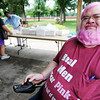 "Globe/T. Rob Brown<br /> Cancer survivor Chet Sweet, of Girard, Kan., sports pink-dyed hair and beard while wearing a ""Real Men Wear Pink"" T-shirt for the National Cancer Survivors Day event at Lincoln Park in Pittsburg, Kan."