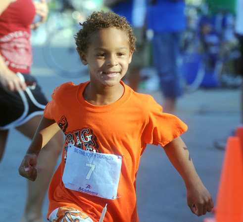 Globe/Roger Nomer<br /> Caleb Noonoo, 6, crosses the finish line to win first place in his age division at the Big Time Youth Triathlon on Saturday.