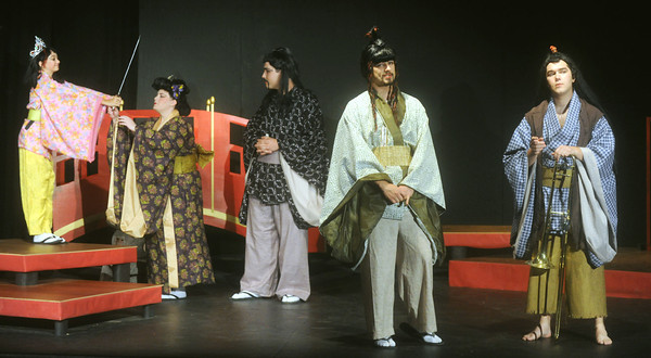"Globe/Roger Nomer<br /> (from left) Julia Oney, as Wing-Ting, Jennifer Brothers, as Gen-Sing, Richard Merriman, as the Mikado, Trent Bauer, as Pish-Tush, and Kevin Nolte, as Nanki-Po, rehearse a scene from ""The Mikado"" at the Stone's Throw Theatre."