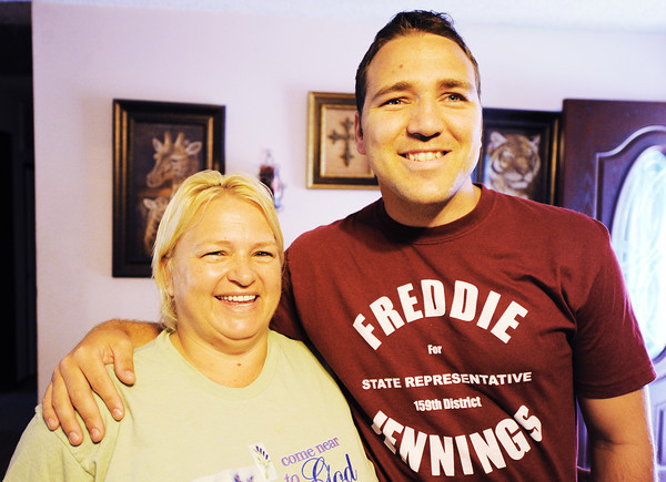 Globe/T. Rob Brown Freddie Jennings, of Goodman, puts his arm around his mother, Kathy Jennings, Thursday morning, June 21, 2012, at her home. Freddie Jennings fought to recover from a near-fatal head injury suffered while in China in 2011.