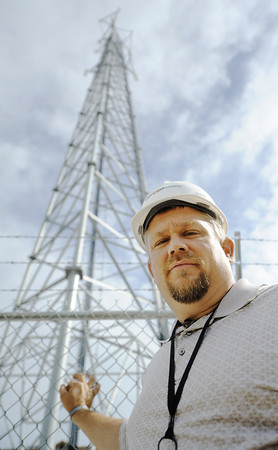 Globe/T. Rob Brown Verizon Wireless RF (radio frequency) technician Travis Goad Friday morning, June 15, 2012, at a tower off 20th Street, near Rex, in the 2011 tornado zone.