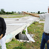 Globe/T. Rob Brown Don and Shirley Conner stand Wednesday morning, June 12, 2012, near their former home in the 2300 block of Missouri Avenue as they talk about the events of May 22, 2011. The couple rode out the storm in the home's crawlspace, which they entered through a hole in their bedroom. They said they didn't believe they could have went outside and made it into the crawlspace's main entrance (background) in time.