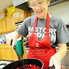 Globe/T. Rob Brown Linda Stegner, of Joplin, makes cherry pie filling for the Fall Fiasco Pie Sale recently.