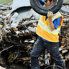 Globe/T. Rob Brown<br /> Jairo Gonzales, of Carthage, separates out a tire after trucks unload debris Friday afternoon, June 1, 2012, at the Galena, Kan., landfill.