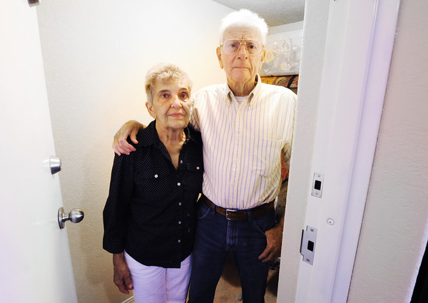 Globe/T. Rob Brown Don and Shirley Conner stand Wednesday morning, June 12, 2012, stand in a storm saferoom in their new home in the 1200 block of 24th Street. The couple rode out the storm in their former home's crawlspace, which they entered through a hole in that home's bedroom. They said they didn't believe they could have went outside and made it into the crawlspace's main entrance in time.