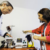 Globe/T. Rob Brown Dr. Thomas Davis, left, and nurse Kathy Alexander, R.N., prepare a defibrillator and the rest of a code cart (which contains life-saving medicines and equipment) at the Gene Taylor Satellite Outpatient Clinic of the Department of Veterans Affairs in Mount Vernon Wednesday morning, June 27, 2012.