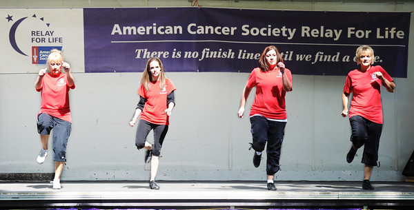 "Globe/T. Rob Brown<br /> The Route 66 Cloggers perform during the American Cancer Society Relay for Life event Saturday afternoon, June 2, 2012, in Carthage Central Park. These four members of the clogging group are, from left: Diane ""Dice"" Gray, of Granby, Jessica Achey, of Lamar, Trisha Massey, of Carl Junction, and instructor Kathy Parrish, of Joplin."