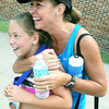 Globe/Roger Nomer<br /> Kathy Wrensch gives her daughter Dani, 10, a hug after learning her time in the Big Time Youth Triathlon on Saturday.