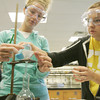 Globe/Roger Nomer<br /> Sara Hoffman, Missouri Southern sophomore, left, and Victoria Winkel, sophomore, filter a solution during their Allied Sciences and Health class on Thursday at MSSU.