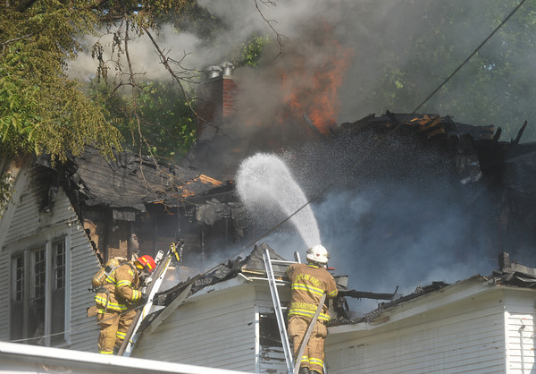 Globe/Roger Nomer<br /> Joplin Firefighters respond to a house fire near Fifth and Sergeant on Wednesday morning.