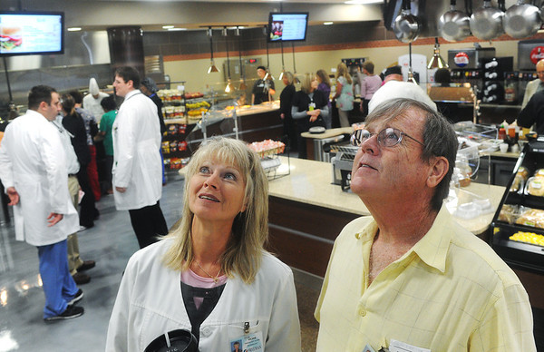 Globe/Roger Nomer<br /> Vickie and Jeff Adkins try to select a salad from the expanded menu at the new Freeman Cafeteria on Monday.