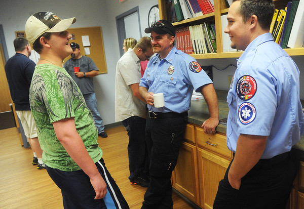 Globe/Roger Nomer<br /> Lage Grigsby, 16, chats with Shane Moore, center, and Torrey Eckert, two of the first responders from the Quapaw Tribe station that helped him and his cousin following the 2011 tornado.