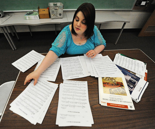 Globe/T. Rob Brown<br /> Kylee VanHorn, Joplin orchestra director for Joplin High School, East Middle School and South Middle School, looks through some of the high school's sheet music in the music department at the freshman and sophomore campus Wednesday morning, June 19, 2013.