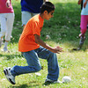 Globe/T. Rob Brown<br /> Adrian Marcos, 13, of Anderson, finds the beeperball first during the United Way Day of Action Friday morning, June 21, 2013, at Schifferdecker Park. Marcos, who is visually impaired, is helped through the Joplin Association for the Blind which receives funding from the United Way.