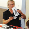Globe/T. Rob Brown<br /> Hugh Merrill, artist, educator and director of Chameleon Arts of Kansas City, pieces photocopied elements together during a workshop Saturday at Spiva Center for the Arts.