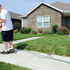Globe/T. Rob Brown<br /> Kelly Maddy trims the verge around his sidewalk Saturday morning, June 15, 2013, outside his Kentucky Avenue home.