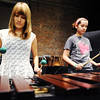 Globe/T. Rob Brown<br /> Joplin High School freshmen Lydia Greenwood (left) and Jacy Welch practice on the keyboard for the front ensemble portion of the drumline Wednesday morning, June 19, 2013, at Memorial Hall.