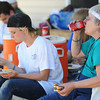 "Globe/T. Rob Brown<br /> Barbara Boviall (right) of Karnak, Ill., and Heather Clark, 17, of Palmyra, Ill., members of the ""Sore Thumbs"" work group, take a lunch break Friday afternoon, June 28, 2013, in a Rebuild Joplin home being constructed in the 1300 block of East 24th Street."