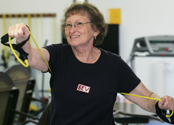 Globe/Roger Nomer<br /> Beverly Cossey does an upper body workout during class at the Joplin Senior Center on Thursday.