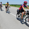 Globe/T. Rob Brown<br /> Cyclists (from left) Taylor Sutton of Peru, Neb., Bob Champlin of Sabetha, Kan., and Ricky Bloesser, of Elkhart, Kan., ride toward Oswego, Kan., Friday afternoon, June 14, 2013, as part of Bike Across Kansas. About 800 cyclists participated in the event.