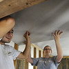 "Globe/T. Rob Brown<br /> Scott Lanbeth (left) of Plainview, Ill., and Caitlin Campbell of Jefferson City, members of the ""Sore Thumbs"" work group, install a piece of sheetrock for the ceiling Friday afternoon, June 28, 2013, in a Rebuild Joplin home being constructed in the 1300 block of East 24th Street."