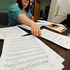 "Globe/T. Rob Brown<br /> Kylee VanHorn, Joplin orchestra director for Joplin High School, East Middle School and South Middle School, looks through some of the high school's sheet music, including ""Rhapsody in Blue,"" in the music department at the freshman and sophomore campus Wednesday morning, June 19, 2013."