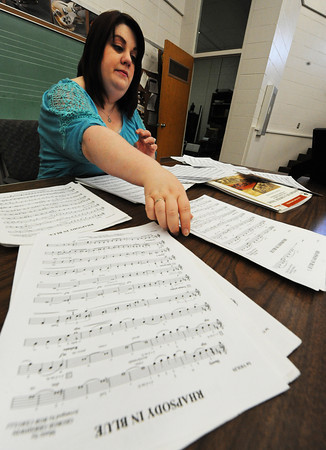 """Globe/T. Rob Brown<br /> Kylee VanHorn, Joplin orchestra director for Joplin High School, East Middle School and South Middle School, looks through some of the high school's sheet music, including """"Rhapsody in Blue,"""" in the music department at the freshman and sophomore campus Wednesday morning, June 19, 2013."""