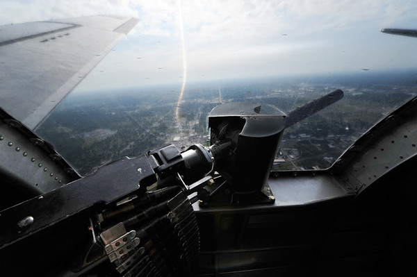 """Globe/T. Rob Brown<br /> The view from a gunner port like what Ken La Near might have seen during World War II on the B-17 he flew in with the US Army Air Corps, during a recent father-son flight in a restored B-17G, """"Sentimental Journey"""" Friday morning, June 14, 2013."""