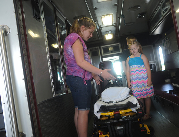 Globe/Roger Nomer<br /> Mason Lillard, 12, show her cousin Allysabeth Grigsby, 7, the ambulence that transported her following the May 22, 2011, tornado during a reunion at the Quapaw Tribe Fire and EMS station on Friday.