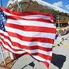 Globe/T. Rob Brown<br /> Large flags fly outside the Monark Baptist Church youth group's TNT Fireworks tent in the Walmart Supercenter parking lot in Neosho, Saturday afternoon, June 29, 2013.