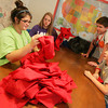 Globe/Roger Nomer<br /> (from left) Volunteers from Trinity Presbyterian Church in Flower Mound Texas, including Brittany Cafferty, 15, Katie Carnahan, 14, Jacob Hardwick, 15, and Caleb Dixon, 14, sort through super hero capes to be included in art packs sent to students in Moore, Okla. affected by last month's tornado. Art Feeds is sending 1,300 art packs to the students, as well as traveling to Moore in early July to conduct art sessions with the students.