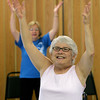 Globe/Roger Nomer<br /> Donna Popplewell does an upper body exercise during class at the Joplin Senior Center on Thursday.