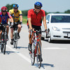 Globe/T. Rob Brown<br /> Cyclists (from left) Taylor Sutton of Peru, Neb., Ricky Bloesser, of Elkhart, Kan., Bob Champlin of Sabetha, Kan., and Austin Cantrell, of Ulysses, Kan., ride toward Oswego, Kan., Friday afternoon, June 14, 2013, as part of Bike Across Kansas. About 800 cyclists participated in the event.