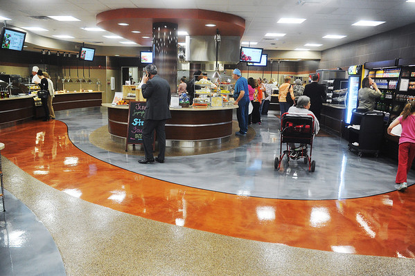 Globe/Roger Nomer<br /> Customers stroll through the newly expanded and remodeled Freeman Cafeteria on Monday.