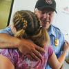 Globe/Roger Nomer<br /> Quapaw Tribe Fire Chief Jeff Reeves gets a hug from Mason Lillard, 12, during a reunion at the station on Friday.