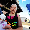 Globe/T. Rob Brown<br /> Savanna Malcolm, 11, of Galena, Kan., pours a snow cone Saturday evening, June 29, 2013, outside the Salvage Yard on South Main Street in Joplin. A group of youth were selling snow cones, cakes and other sweets to benefit people affected by the Moore, Okla., tornado. The Salvage Yard is a coffee bar, night club and church.
