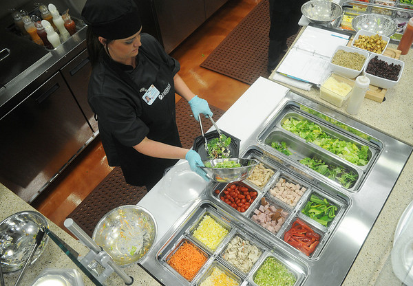 Globe/Roger Nomer<br /> Krista Bogle fixes a salad at the new Freeman Cafeteria on Monday afternoon.