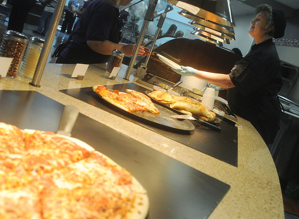 Globe/Roger Nomer<br /> Galina Scherbakoff serves a customer at the pasta and pizza section of the new Freeman Cafeteria on Monday.