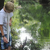 Globe/Roger Nomer<br /> Mason Phillips, 12, Webb City, checks the turbidity of Silver Creek during a demonstration by the Wildcat Stream Team on Monday morning at Wildcat Glades.
