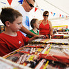 Globe/T. Rob Brown<br /> The Mackey family, of Neosho, looks at the fireworks selection in the Monark Baptist Church youth group's TNT Fireworks tent in the Walmart Supercenter parking lot in Neosho, Saturday afternoon, June 29, 2013. Pictured from left are: Carter Mackey, 7, Garrett Mackey, Kelsey Mackey, 8, and Heather Mackey.