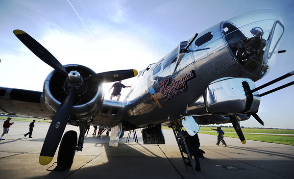 """Globe/T. Rob Brown<br /> The Commemorative Air Force crew prepares the restored B-17G """"Sentimental Jounrey"""" for Richard and Ken La Near's father-son flight Friday morning, June 14, 2013."""