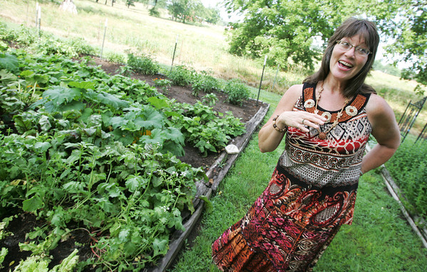 Globe/Roger Nomer<br /> Becky Brannack talks about her garden which she shares the fruits of with her students and friends.