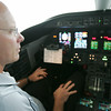 Globe/Roger Nomer<br /> Pilot Mike Bentley checks his instrument panel in a plane used for Tamko flights at the Joplin Regional Airport on June 17, 2013.