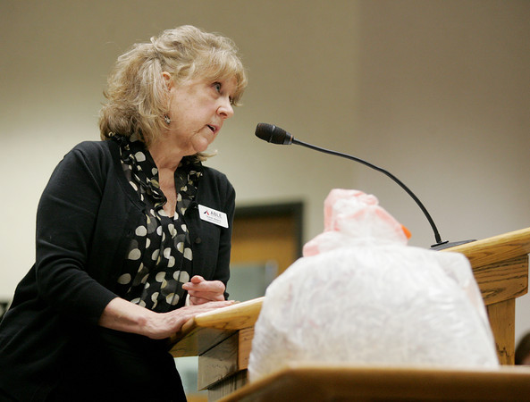 Globe/Roger Nomer<br /> Susan Adams addresses the council using a prop representing her family's weeks-worth of trash since they started recycling.  Adams was one of several supporters of recycling addressing the council on Monday evening.
