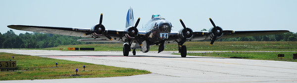 Globe/T. Rob Brown<br /> A B-17 Flying Fortress taxies in on the Joplin Regional Airport runway Wednesday morning, June 12, 2013.