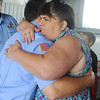 Globe/Roger Nomer<br /> Sharon Lillard, grandmother of Lage Grigsby and Mason Lillard, gives a hug to Torrey Eckert, one of the firemen who helped rescue her grandchildren, during a reunion at the Quapaw Tribe Fire and EMS station on Friday.