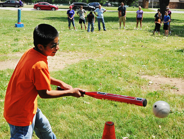 Globe/T. Rob Brown<br /> Adrian Marcos, 13, of Anderson, puts the beeperball into play during the United Way Day of Action Friday morning, June 21, 2013, at Schifferdecker Park. Marcos, who is visually impaired, is helped through the Joplin Association for the Blind which receives funding from the United Way.